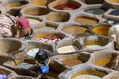FEZ, MOROCCO – APRIL 10: Local people working as a tanner in t royalty free stock photography