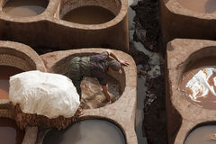 FEZ, MOROCCO – FEBRUARY 20, 2017 : Man working at the famous Chouara Tannery in the medina of Fez, Morocco Stock Photography