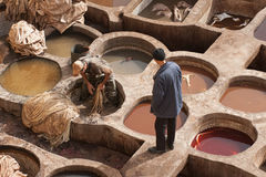 FEZ, MOROCCO – FEBRUARY 20, 2017 : Men working at the famous Chouara Tannery in the medina of Fez, Morocco Stock Photos