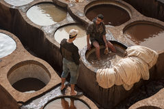FEZ, MOROCCO – FEBRUARY 20, 2017 : Men working at the famous Chouara Tannery in the medina of Fez, Morocco Royalty Free Stock Photos