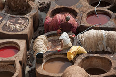 FEZ, MOROCCO – FEBRUARY 20, 2017 : Men working at the famous Chouara Tannery in the medina of Fez, Morocco Stock Image