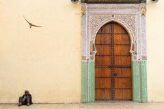 FEZ, MOROCCO - APRIL 15: Unkown man relaxing near to entrance of Stock Image