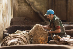 FEZ, MOROCCO - APRIL 19: Workers at leather factory perform the Royalty Free Stock Photography
