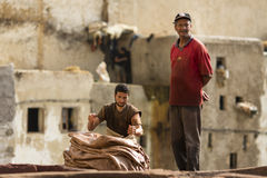 FEZ, MOROCCO - APRIL 19: Workers at leather factory perform the Royalty Free Stock Image