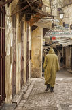 FEZ, MOROCCO - FEBRUARY 20, 2017: Unidentified man walking in the medina of Fez Stock Image