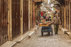 FEZ, MOROCCO - FEBRUARY 20, 2017: Unidentified men in the medina of Fez Stock Images
