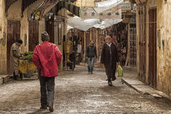FEZ, MOROCCO - FEBRUARY 20, 2017: Unidentified men walking in the medina of Fez Royalty Free Stock Photos