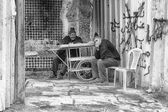 FEZ, MOROCCO - FEBRUARY 18, 2017: Unidentified people sitting in the medina of Fez Royalty Free Stock Images