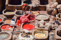 FEZ, MOROCCO, MAY 31, 2012- Workers in the Chouwara Tannery in the medina of Fez Stock Photography