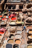 FEZ, MOROCCO, MAY 31, 2012- Workers in the Chouwara Tannery in the medina of Fez Stock Image