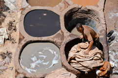 FEZ, MOROCCO, MAY 31, 2012- Workers in the Chouwara Tannery in the medina of Fez Stock Photos