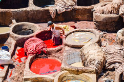 FEZ, MOROCCO, MAY 31, 2012- Workers in the Chouwara Tannery in the medina of Fez Royalty Free Stock Images