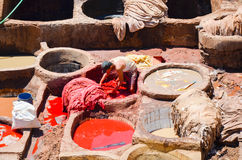 FEZ, MOROCCO, MAY 31, 2012- Workers in the Chouwara Tannery in the medina of Fez Stock Photo
