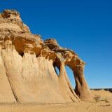 Fezzi Jaren Arch, Natural Rock Arch, Akakus, Libya. Fezzi Jaren Arch - Huge natural rock arch - Akakus (Acacus) Mountains, Sahara, Libya royalty free stock images