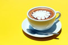 Ffee cup of hot latte art on Yellow background.  royalty free stock photos