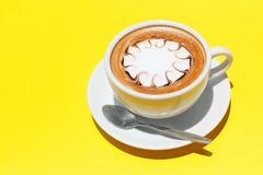 Coffee cup of hot latte art on Yellow background.  royalty free stock photography