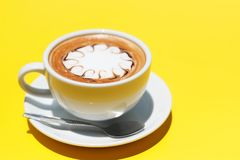 Ffee cup of hot latte art on Yellow background.  stock images