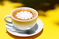 Ffee cup of hot latte art on Yellow background.  royalty free stock photography