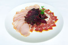 Fferent varieties of meat sliced on a plate Royalty Free Stock Photography