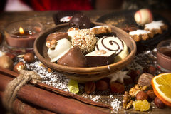 FFestive background with chocolate, nuts, cookies, spices on woo. Festive background with chocolate, nuts, cookies, spices on wooden table Royalty Free Stock Images