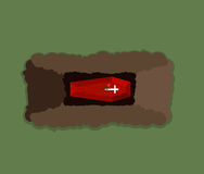 Öffnen Sie Grab Sarg in der Grube Blumen-Rosen auf Dach des Grabs Lizenzfreies Stockfoto