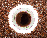 Fframe of coffee beans for the photos with a cup Stock Image