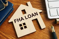 Free FHA Loan Written On The Model Of Home Stock Photos - 138921923