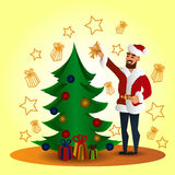 Fhather-Santa Claus and christmas tree Stock Image
