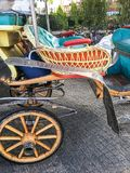Fiacre, cart on the street background. Wood stock images
