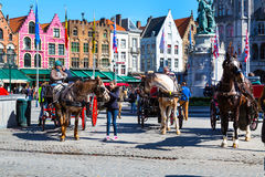 Fiakers waiting for tourists in Bruges, Belgium Royalty Free Stock Photography