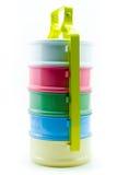 Fiambrera brillante y del color de la melamina del portador del estilo aislada detrás Imagen de archivo libre de regalías