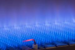 Fiamma del gas dentro della caldaia a gas Fotografia Stock