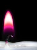 Fiamma di candela viola Immagini Stock Libere da Diritti