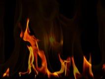 Fiamme del fuoco su priorità bassa nera Immagine Stock