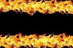 Fiamme del fuoco sul nero Fotografie Stock Libere da Diritti
