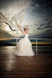 Fiancé in the wind. Pretty lady in a wedding dress on deck Royalty Free Stock Photos