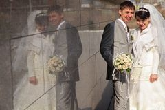 Fiance and bride and reflection on wall Royalty Free Stock Photo