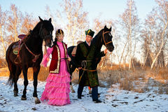 Fiance and fiancee. On an equestrian walk royalty free stock photography