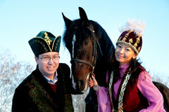 Fiance and fiancee. On an equestrian walk royalty free stock image