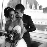 Fiance holds bride by the shoulders before the panoramic windows Royalty Free Stock Photo