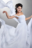 Fiance and the wind. Woman in a wedding dress Royalty Free Stock Photos
