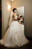 Fiancee. Vertical wedding portrait beautifull  fiancee in white dress. hi ISO Stock Images