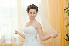 Fiancee. Vertical wedding portrait beautifull  fiancee in white dress, soft light Royalty Free Stock Photo