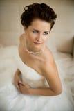 Fiancee. Vertical wedding portrait beautifull  fiancee in white dress, soft light Stock Photos