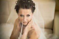 Fiancee. Vertical wedding portrait beautifull  fiancee in white dress Royalty Free Stock Photos