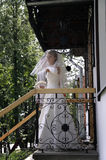 Fiancee on the porch of the house royalty free stock photo