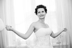 Fiancee. Vertical wedding portrait beautiful  fiancee in white dress, soft light, black-and-white photo Royalty Free Stock Images