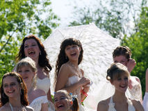 Fiancees laugh, girl with an umbrella stock images