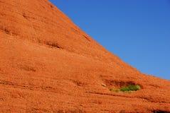 Fianco di una montagna rosso della roccia Fotografia Stock