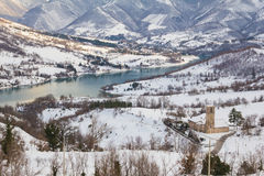 Fiastra lake with snow on the national park of Sibillini mountains Royalty Free Stock Photo
